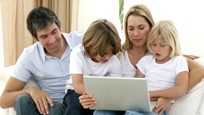 stock-footage-happy-family-at-home-using-a-laptop-shopping-online-footage-in-high-definition
